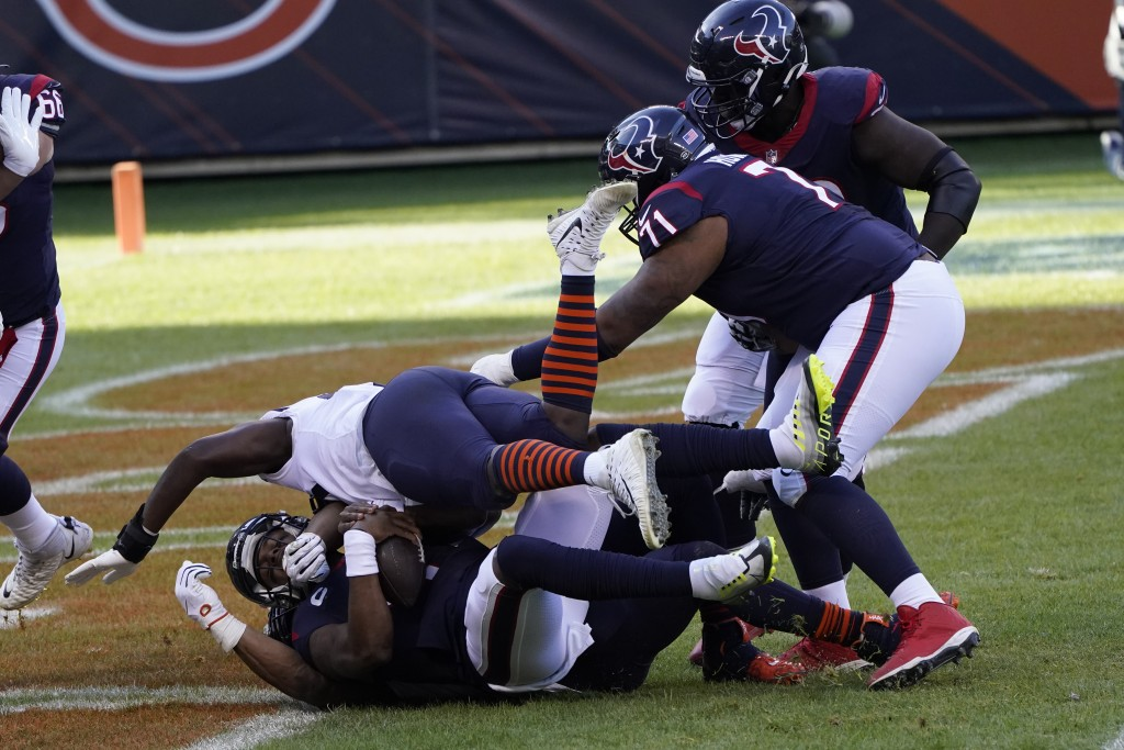 Houston Texans quarterback Deshaun Watson (4) is sacked for a safety by Chicago Bears' Khalil Mack (52) during the first half of an NFL football game,...