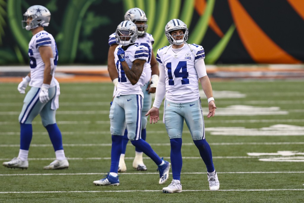 Dallas Cowboys quarterback Andy Dalton (14) reacts to an intentional grounding call in the second half of an NFL football game against the Cincinnati ...
