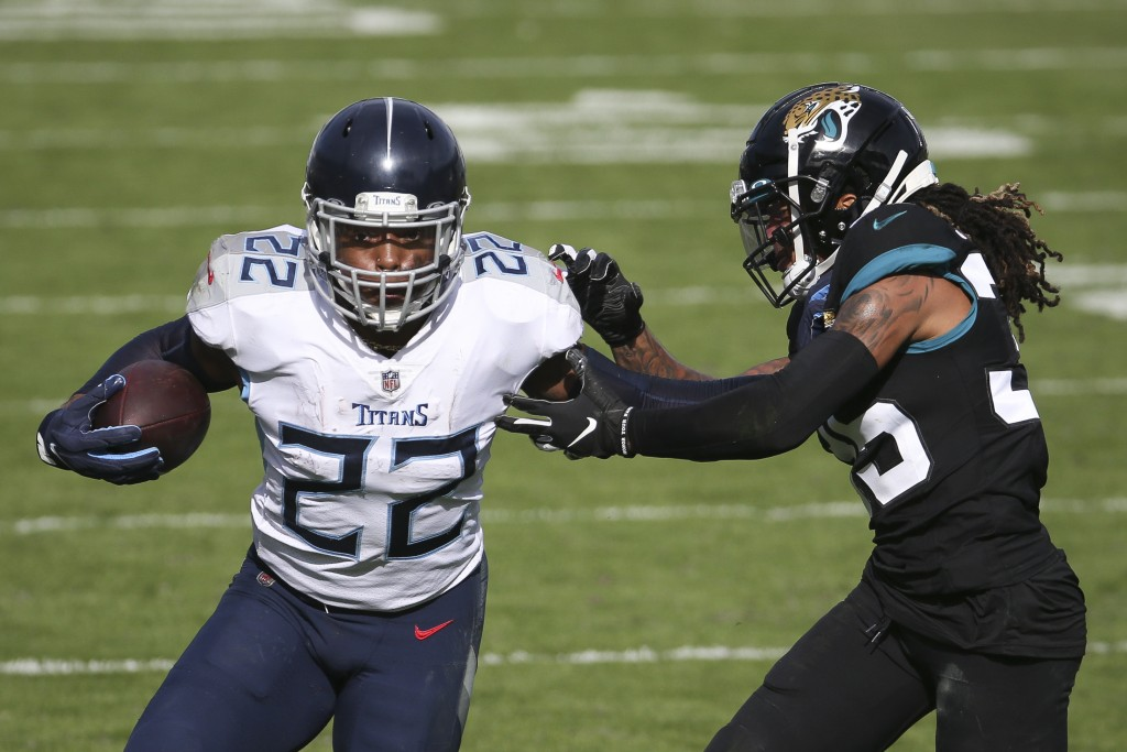 Tennessee Titans running back Derrick Henry (22) gains yardage as he tries to get around Jacksonville Jaguars cornerback Sidney Jones during the first...