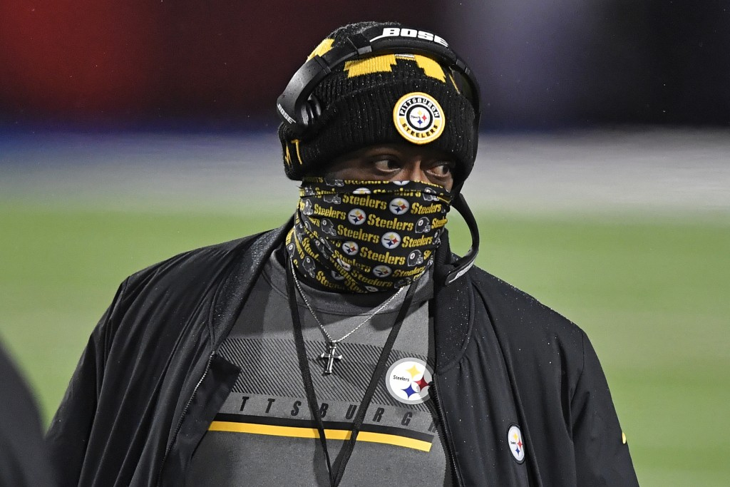 Pittsburgh Steelers head coach Mike Tomlin walks on the sideline during the first half of an NFL football game against the Buffalo Bills in Orchard Pa...