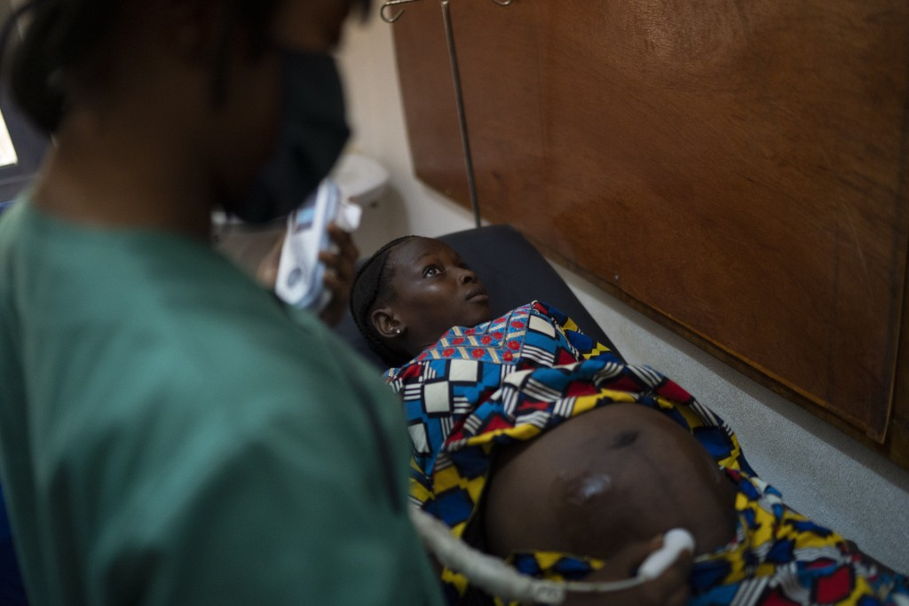 Mariama is attended to in a health unit where several women look for assistance for their prenatal care in Koidu, district of Kono, Sierra Leone, Tues...