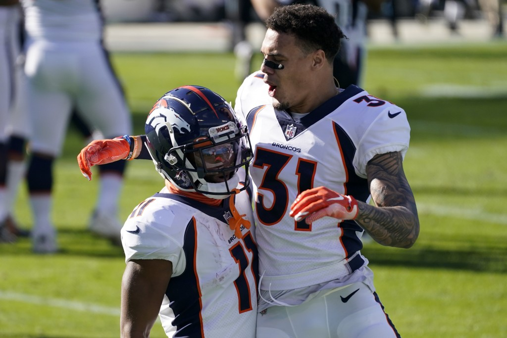 Denver Broncos wide receiver Diontae Spencer, left, celebrates after scoring with safety Justin Simmons during the first half of an NFL football game ...