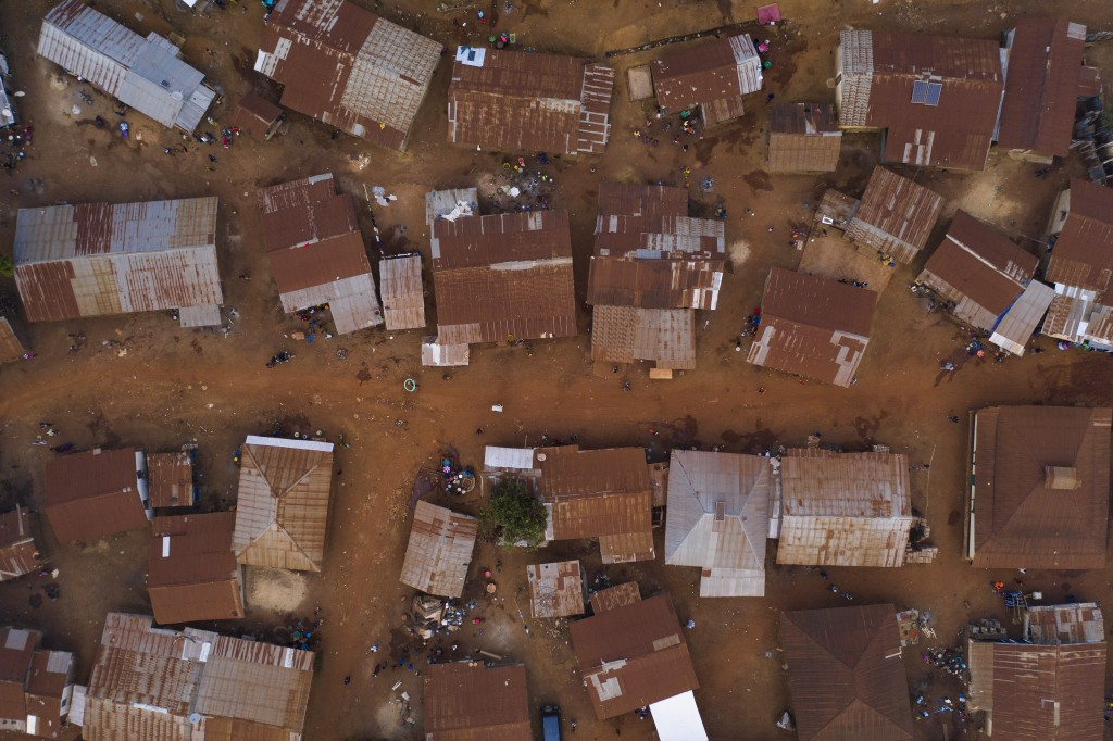 This Sunday, Nov. 22, 2020 photo shows homes in Komao village, on the outskirts of Koidu, district of Kono, Sierra Leone. Sierra Leone closed its bord...