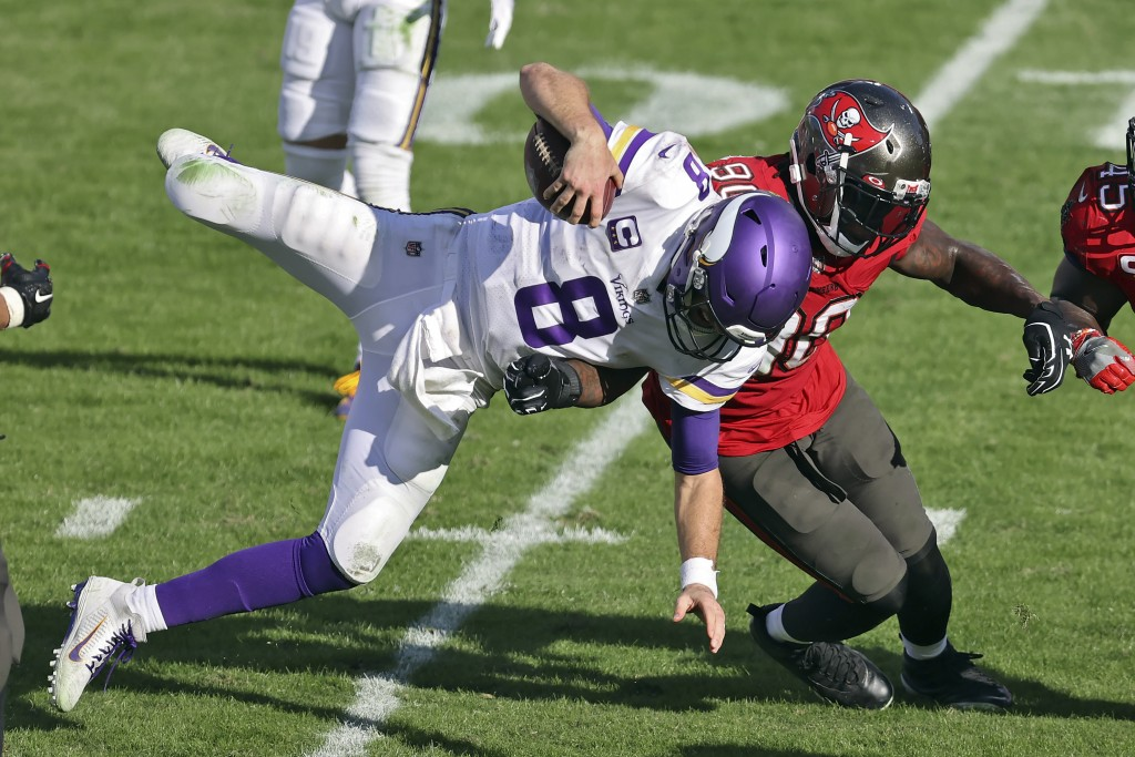 Minnesota Vikings quarterback Kirk Cousins (8) gets upended by Tampa Bay Buccaneers outside linebacker Jason Pierre-Paul (90) during the second half o...