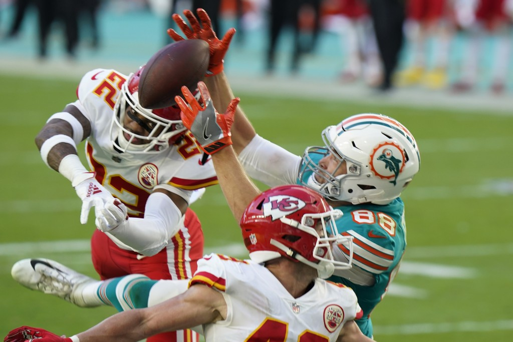 Miami Dolphins tight end Mike Gesicki (88) catches a touchdown pass, during the second half of an NFL football game against the Kansas City Chiefs, Su...