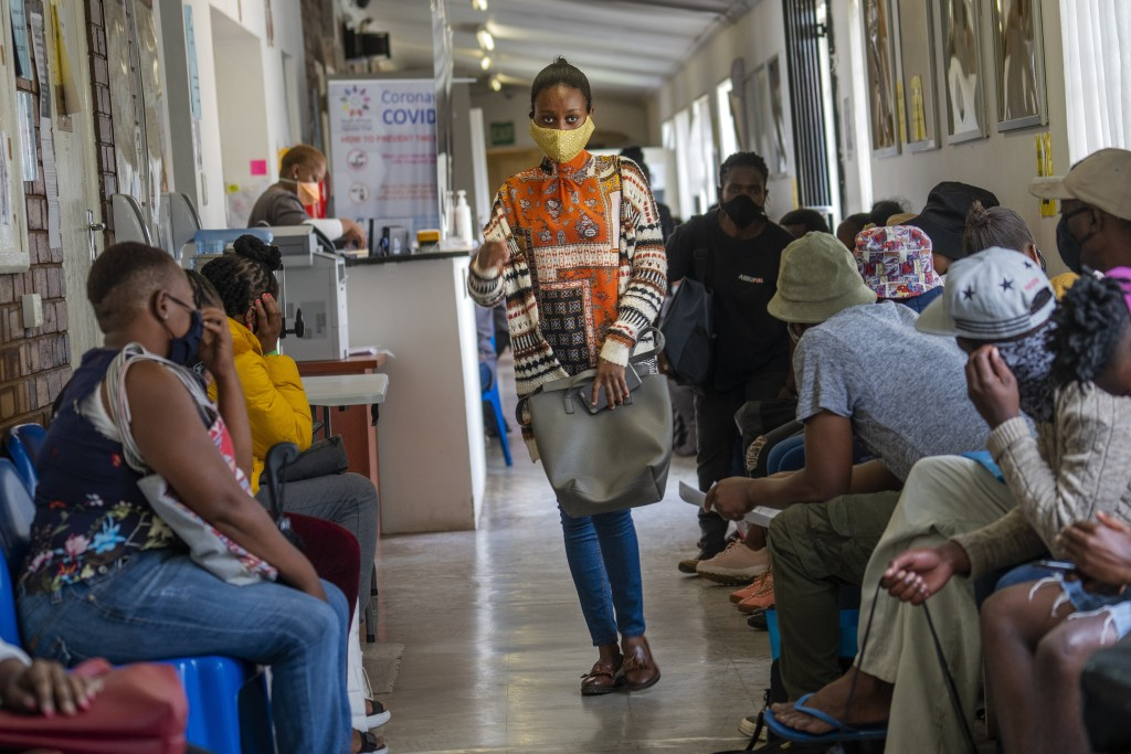 Volunteers wait to be checked at a vaccine trial facility for AstraZeneca at Soweto's Chris Sani Baragwanath Hospital outside Johannesburg, South Afri...