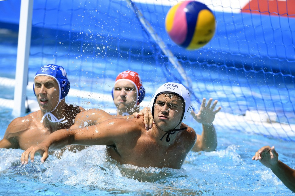 Ben Hallock, right, of the U.S. and Dmitrii Kholod of Russia fight for the ball during the men's water polo Group D third round match of the 17th FINA...