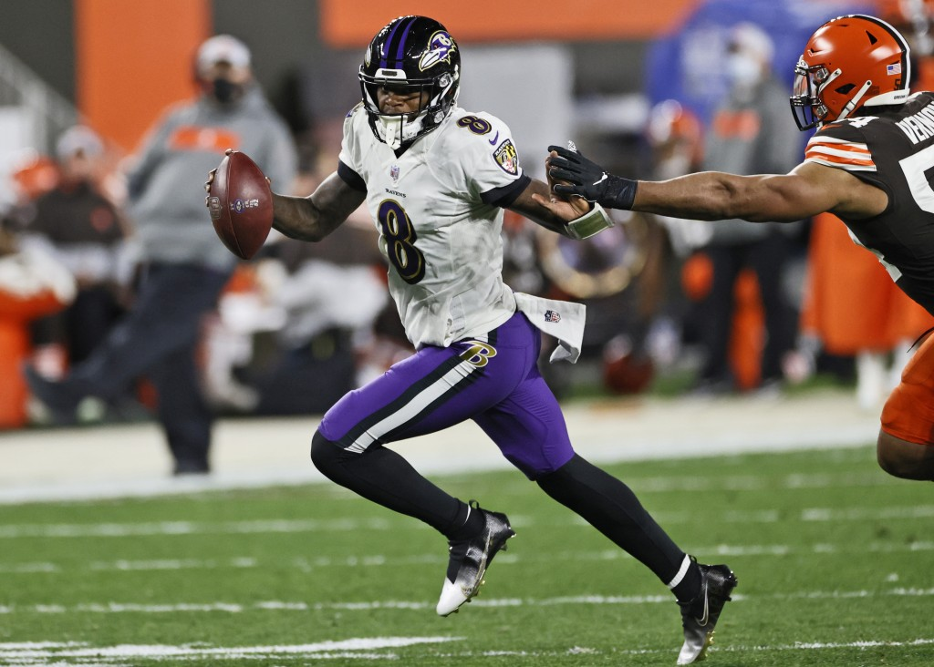 Baltimore Ravens quarterback Lamar Jackson (8) scrambles during the first half of an NFL football game against the Cleveland Browns, Monday, Dec. 14, ...