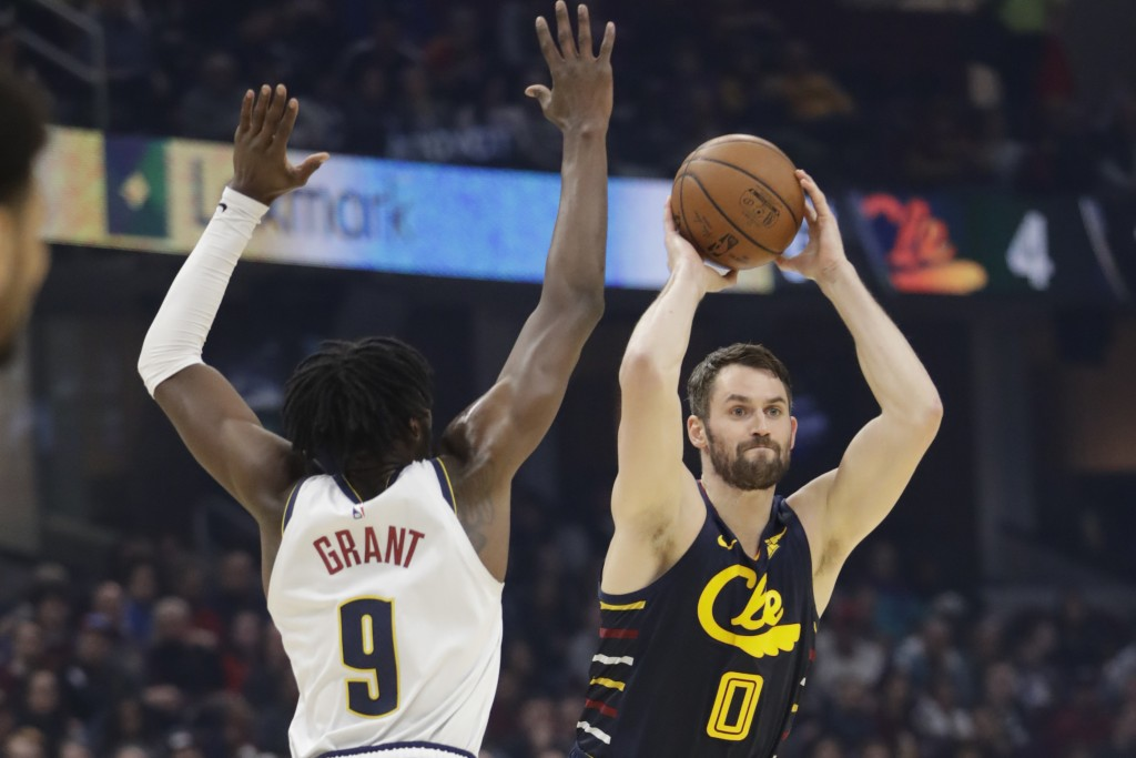 File-This March 7, 2020, file photo shows Cleveland Cavaliers' Kevin Love (0) passing against Denver Nuggets' Jerami Grant (9) in the first half of an...