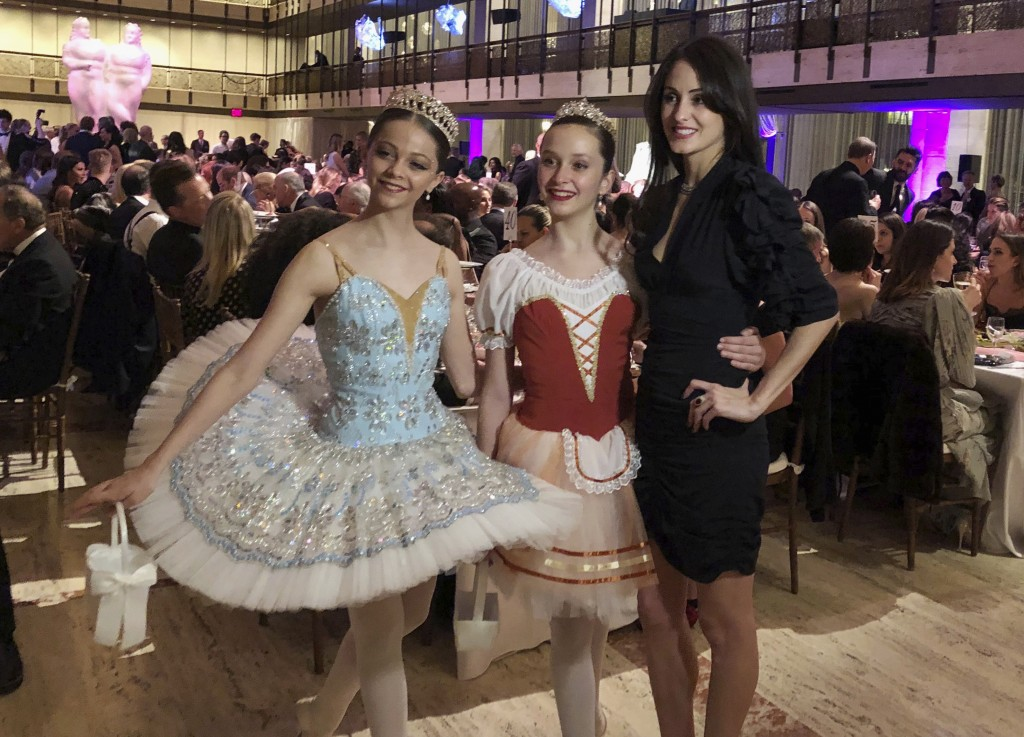 FILE - In this image taken from video, choreographer Melanie Hamrick poses for a photo with young dancers at the gala of Youth America Grand Prix, the...