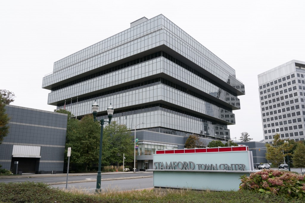 FILE - This Oct. 21, 2020 file photo shows Purdue Pharma headquarters in Stamford, Conn. Two members of the Sackler family have agreed to make a rare ...