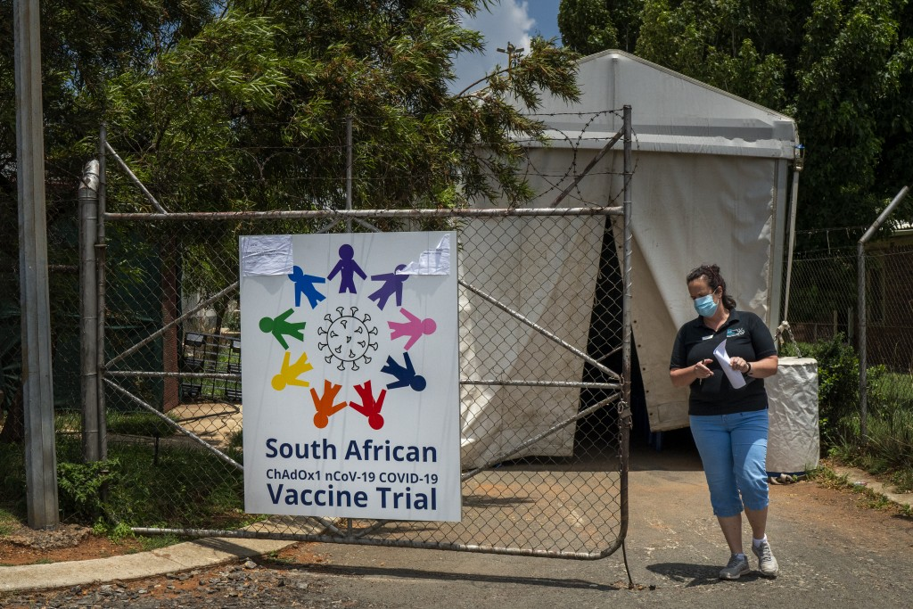 A researcher walks out of a COVID-19 vaccine trial facility at Soweto's Chris Sani Baragwanath Hospital outside Johannesburg, South Africa, Monday Nov...