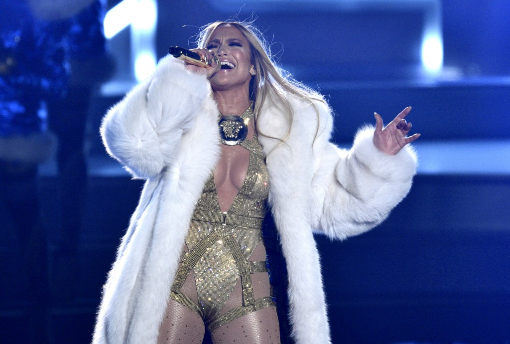 FILE - Video Vanguard award recipient Jennifer Lopez performs at the MTV Video Music Awards in New York on Aug. 20, 2018.  Lopez will help bring in th...