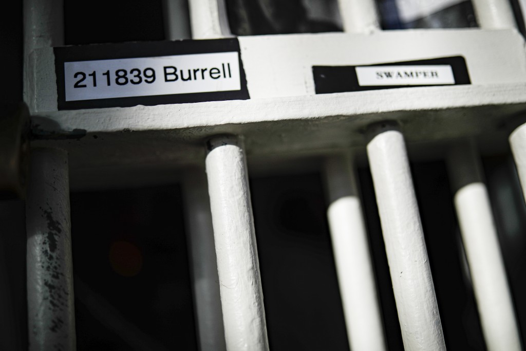 FILE - In this Feb. 13, 2020, file photo, Myon Burrell's inmate number is labeled on his cell's bars at the Minnesota Correctional Facility in Stillwa...
