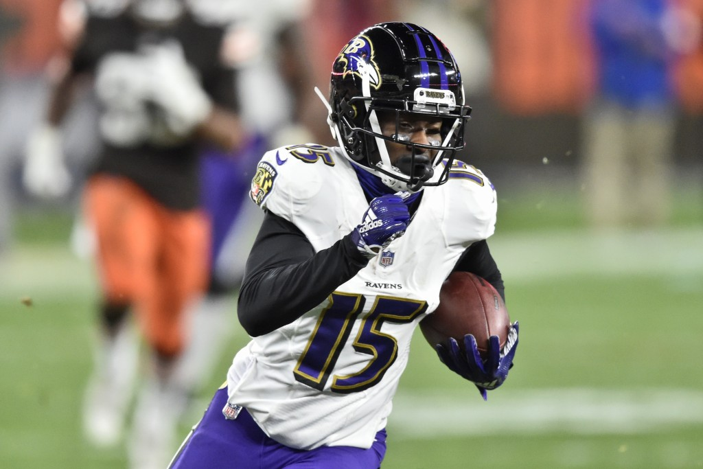 Baltimore Ravens wide receiver Marquise Brown (15) runs after catching a pass for a 44-yard touchdown during the second half of an NFL football game a...