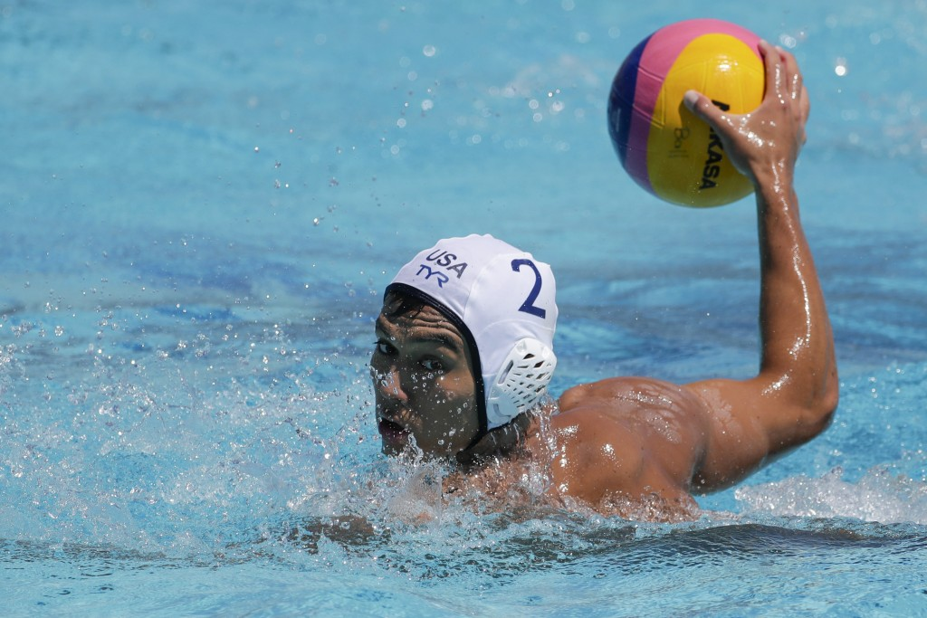 FILE - U.S. men's national water polo player Johnny Hooper prepares to shoot during a training session in Torrance, Calif, in this Monday, July 1, 201...