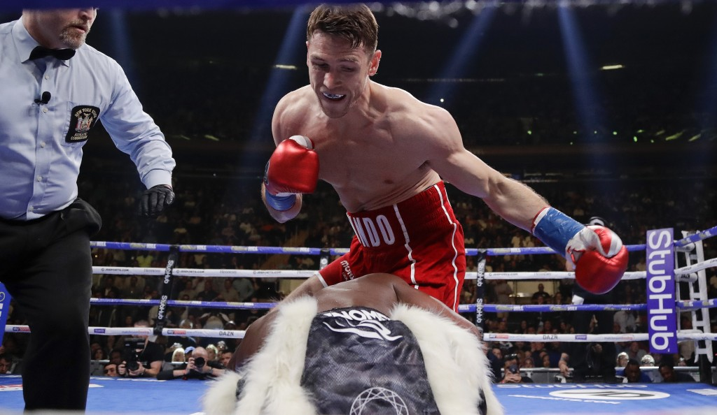 FILE - In this Saturday, June 1, 2019 file photo, England's Callum Smith, above, knocks down Hassan N'Dam, of France, during the first round of a supe...