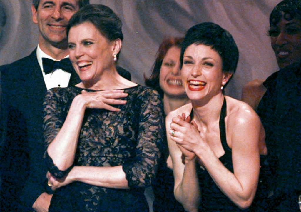 FILE - Anne Reinking, left, and Bebe Neuwirth share a laugh on stage while accepting the award for best revival of a musical during the 51st Annual To...