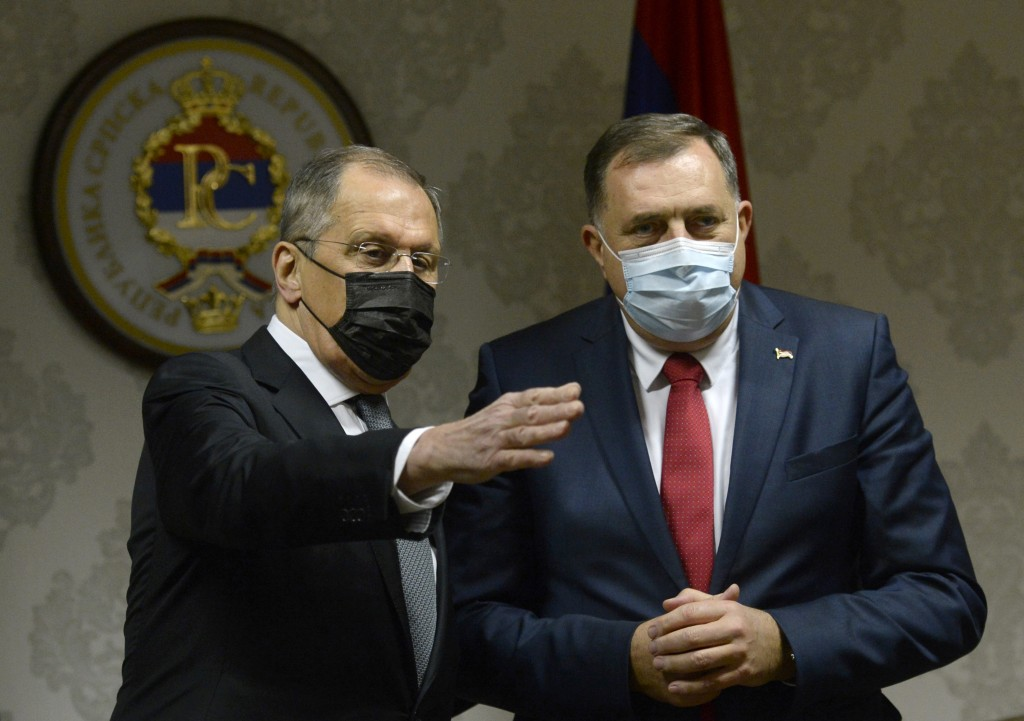 Russian Foreign Minister Sergey Lavrov, left, speaks with Bosnian Serb official Milorad Dodik, who is the member of Bosnia's multi-ethnic presidency i...