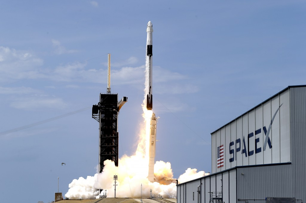 FILE - In this May 30, 2020, file photo, a SpaceX Falcon 9, with NASA astronauts Doug Hurley and Bob Behnken in the Dragon crew capsule, lifts off fro...