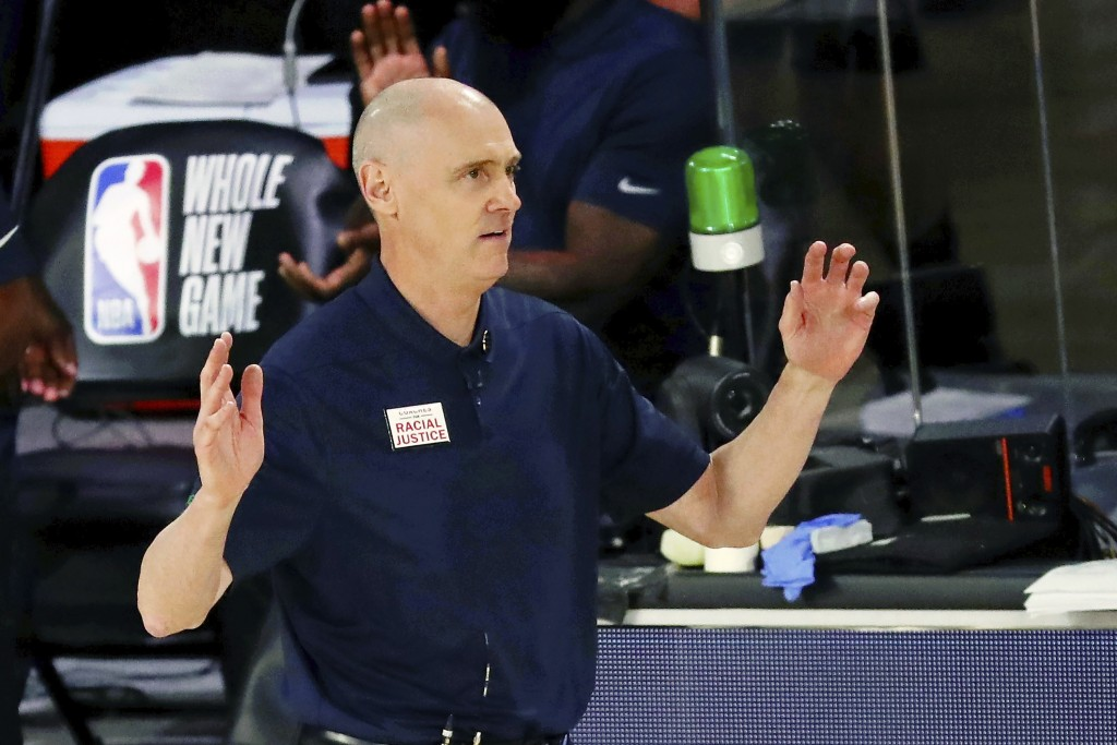 FILE - Dallas Mavericks coach Rick Carlisle reacts during the second half of the team's NBA basketball game against the Portland Trail Blazers in Lake...