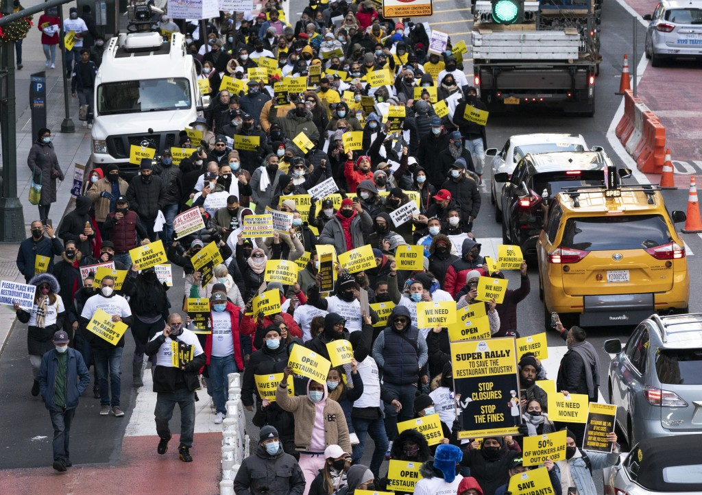 Restaurant and bar owners, employees and union workers march on 42nd Street in support of the restaurant industry, Tuesday, Dec. 15, 202,0 in New York...
