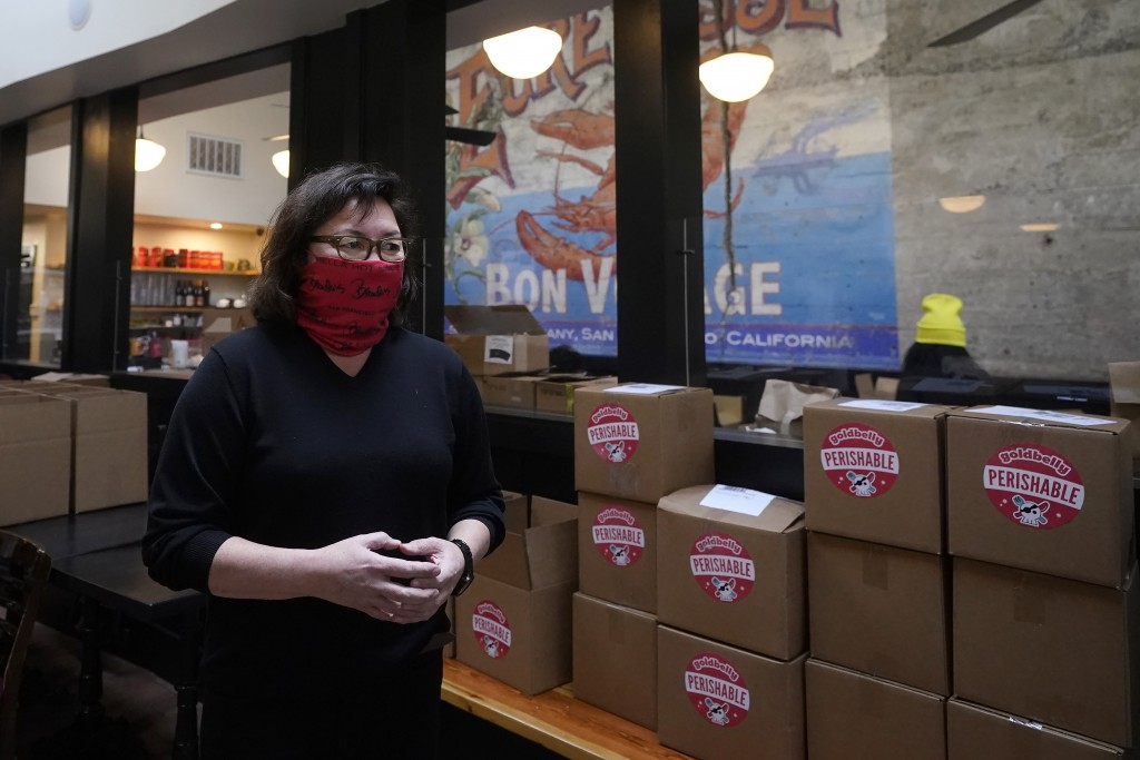 Chef Proprieter Brenda Buenviaje is interviewed next to boxes to shipped at Brenda's French Soul Food in San Francisco, Wednesday, Dec. 9, 2020. In pr...