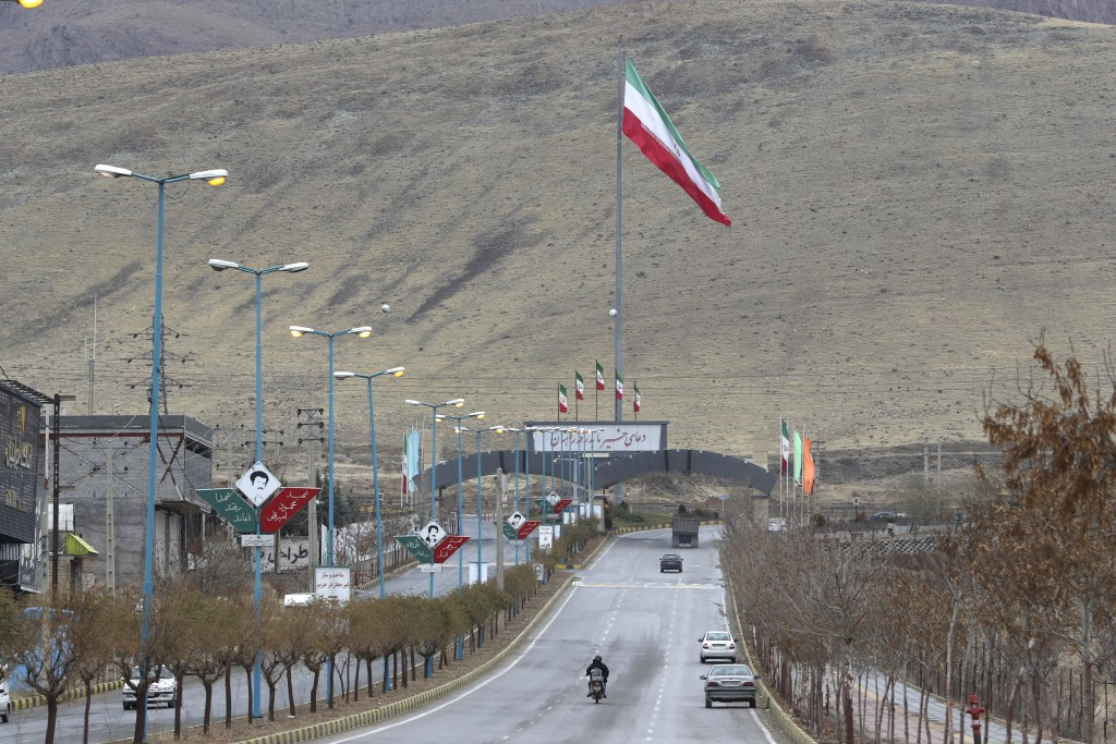 Iran's flag waves at the entrance of Absard,  the town where Mohsen Fakhrizadeh, an Iranian scientist linked to the country's nuclear program was kill...
