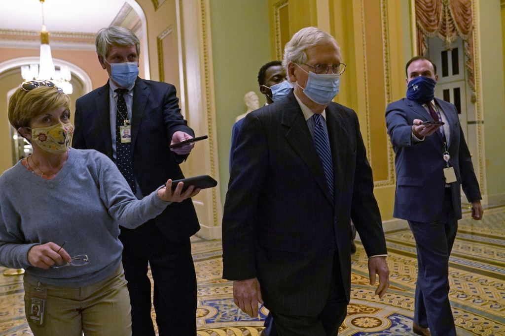 Senate Majority Leader Mitch McConnell of Ky., walks past reporters on Capitol Hill in Washington, Tuesday, Dec. 15, 2020. (AP Photo/Susan Walsh)