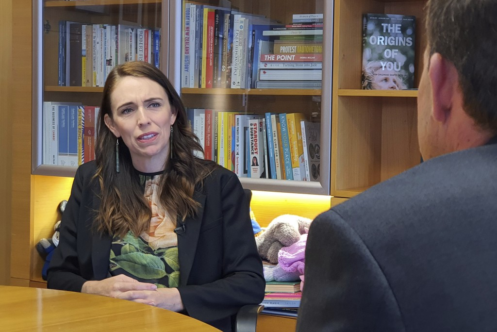 New Zealand's Prime Minister Jacinda Ardern is interviewed in her office at the parliament in Wellington, Wednesday, Dec. 16, 2020. New Zealand this y...