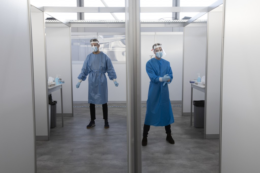 Medical staff wait for the next in line for a throat and nasal swab at a COVID-19 testing facility of the Municipal Health Authority GGD, in Utrecht, ...