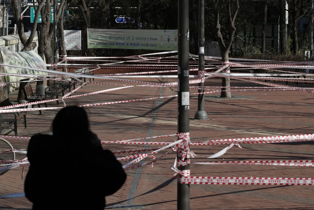 A park is taped off for the social distancing measures and a precaution against the coronavirus in Seoul, South Korea, Wednesday, Dec. 16, 2020. (AP P...