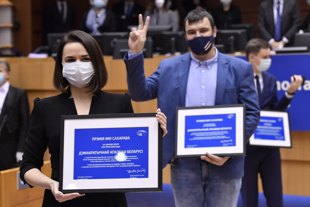Belarus opposition leader Svetlana Tikhanovskaya poses among others with their prizes during the Sakharov Prize ceremony at the European Parliament in...
