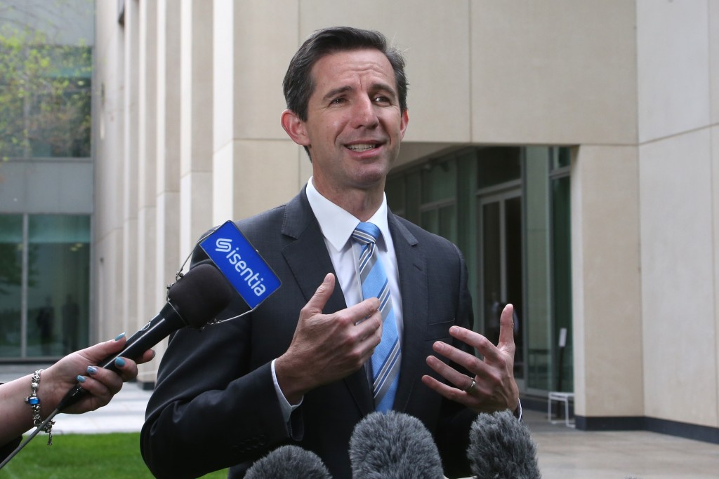 FILE- In this Oct. 16, 2019, file photo, Australia's Trade Minister Simon Birmingham addresses media outside the Parliament House in Canberra, Austral...