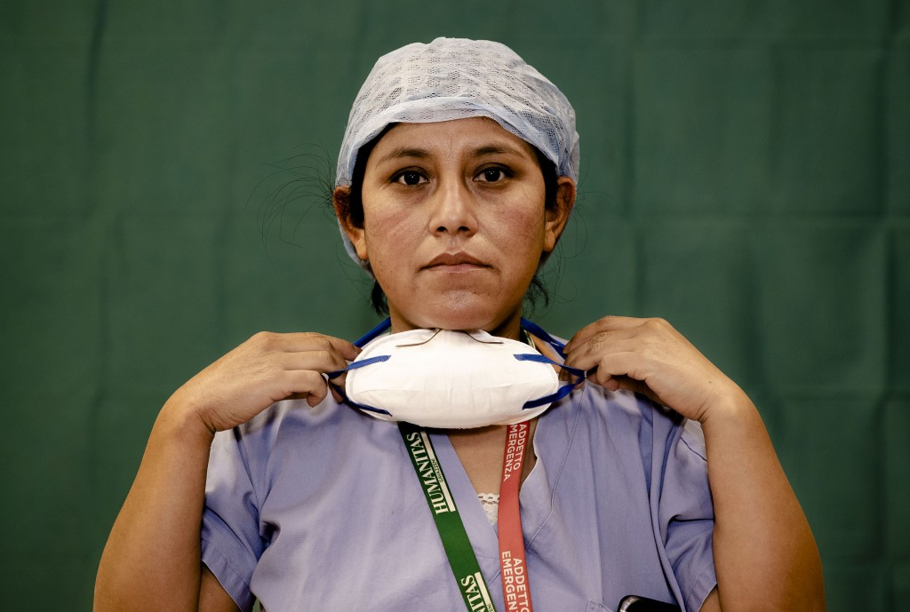 Ana Travezano, 39, a nurse at the Humanitas Gavazzeni Hospital in Bergamo, Italy poses for a portrait at the end of her shift Friday, March 27, 2020. ...