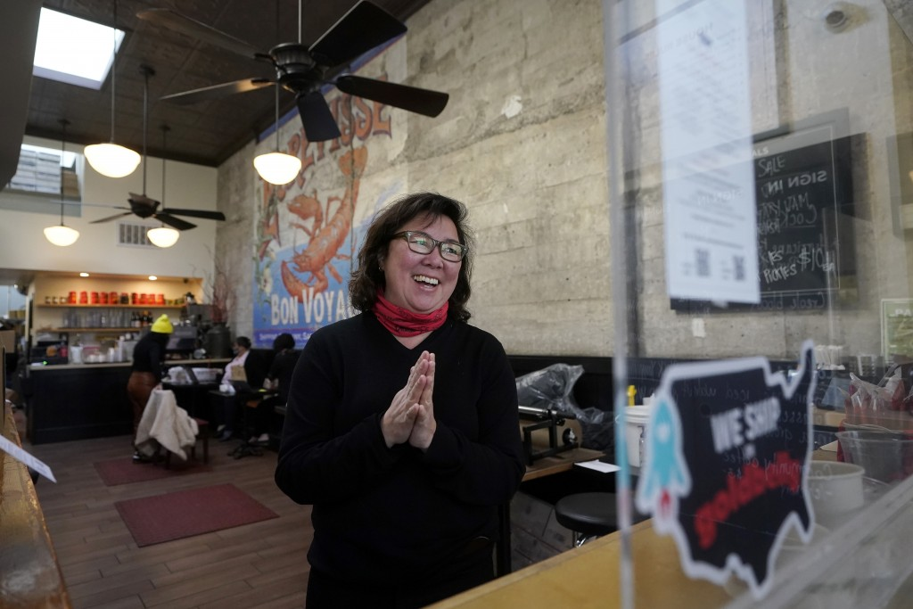 Chef Proprieter Brenda Buenviaje smiles as she is interviewed at Brenda's French Soul Food in San Francisco, Wednesday, Dec. 9, 2020. In pre-pandemic ...