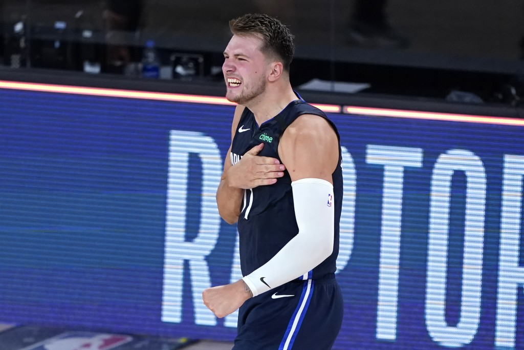 FILE - Dallas Mavericks' Luka Doncic celebrates after making a game-winning three-point basket against the Los Angeles Clippers during overtime of an ...