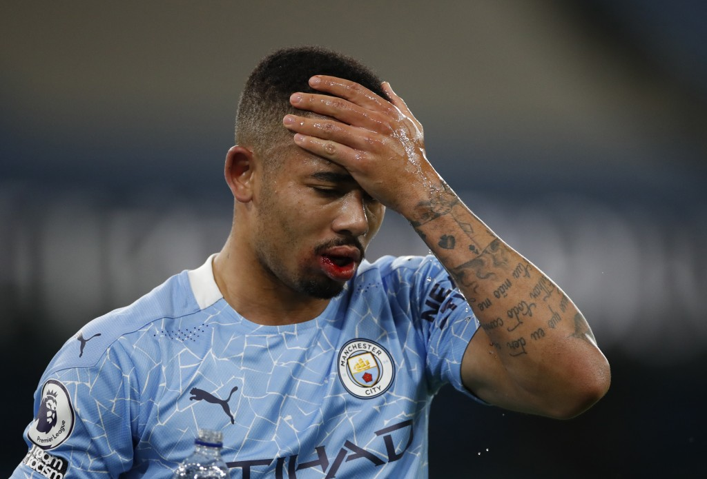 Manchester City's Gabriel Jesus wipes his face with water after taking a knock during their English Premier League soccer match between Manchester Cit...