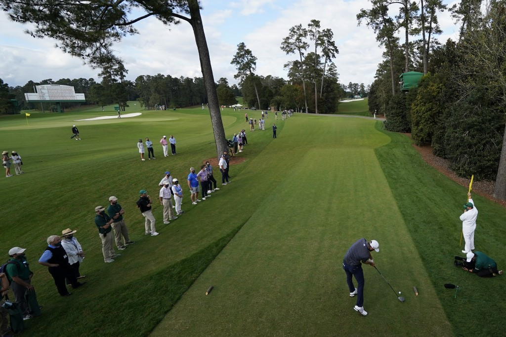 FILE - Dustin Johnson tees off on the 18th hole during the final round of the Masters golf tournament in Augusta, Ga., in this Sunday, Nov. 15, 2020, ...