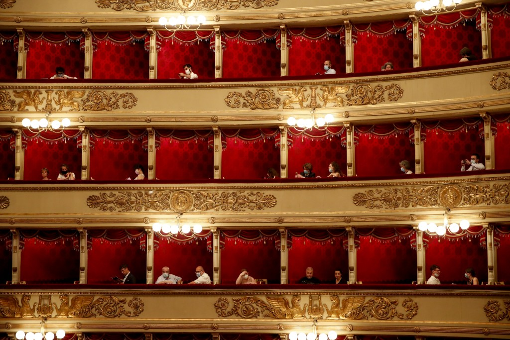 Spectators wearing masks wait for a show at La Scala theater in Milan, Italy, on Monday, July 6, 2020. The opera house reopened Monday after a four-mo...