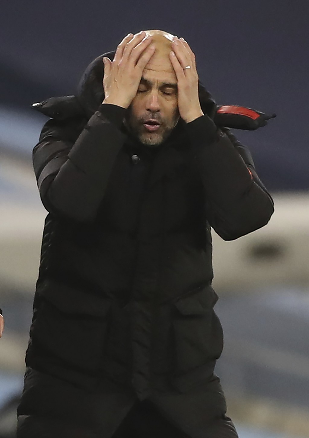 Manchester City's head coach Pep Guardiola reacts during their English Premier League soccer match between Manchester City and West Bromwich Albion at...