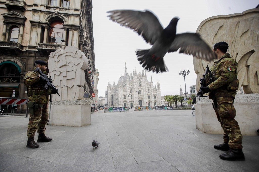 Soldiers patrol Milan, Italy, on Friday, March 20, 2020, with the Duomo gothic cathedral in the background. Mayors of many towns in Italy are asking f...
