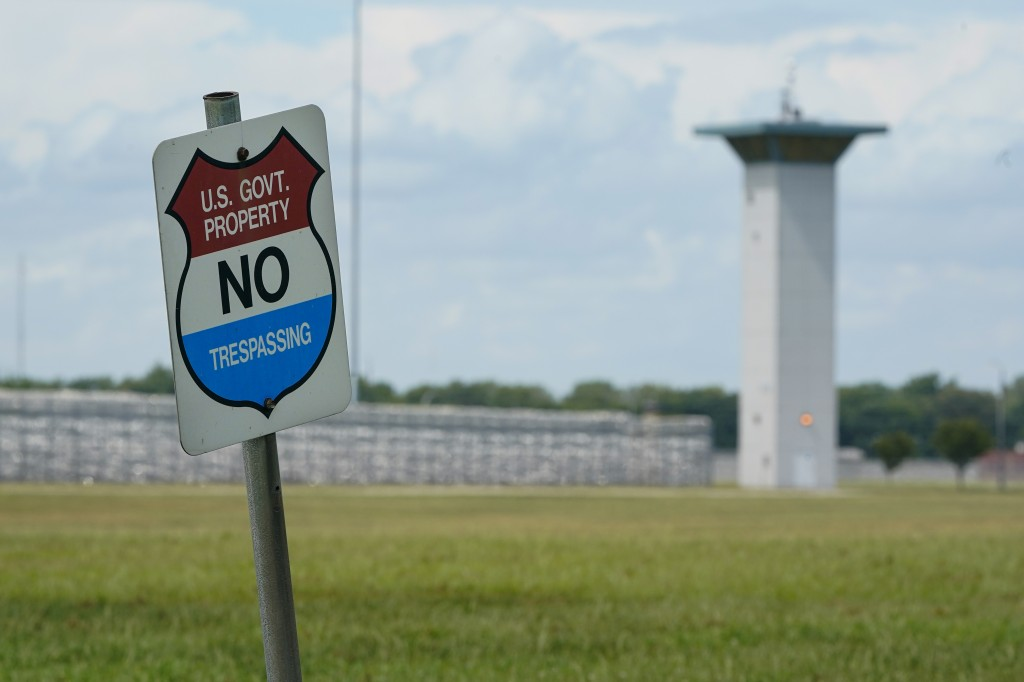 In this Aug. 28, 2020, file photo, a no trespassing sign is displayed outside the federal prison complex in Terre Haute, Ind. A newly released report ...