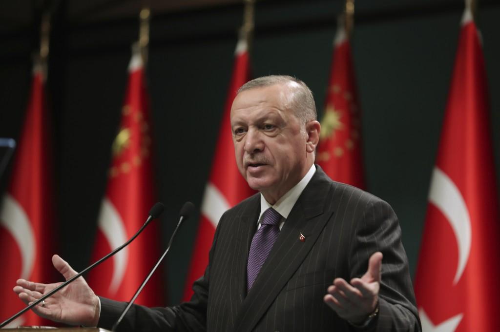 Turkey's President Recep Tayyip Erdogan speaks after a cabinet meeting, in Ankara, Turkey, Monday, Dec. 14, 2020. Erdogan has announced a four-day loc...