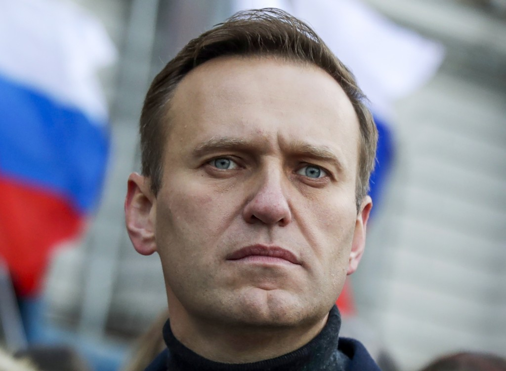 FILE - In this Saturday, Feb. 29, 2020 file photo, Russian opposition activist Alexei Navalny takes part in a march in memory of opposition leader Bor...