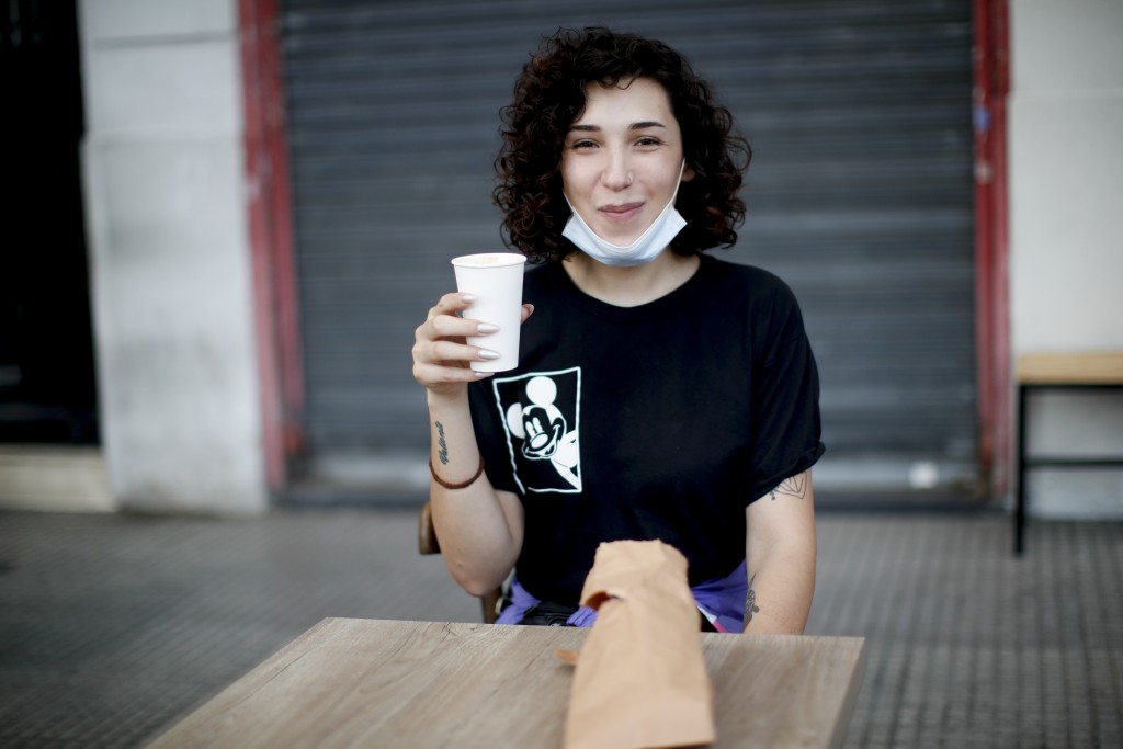 Artist Emma Lusicich poses for a photo outside a cafe in Buenos Aires, Argentina, Tuesday, Nov. 24, 2020. In September, President Alberto Fernández si...