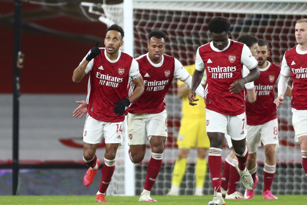 Arsenal's Pierre-Emerick Aubameyang, left, celebrates after scoring his side's first goal during an English Premier League soccer match between Arsena...