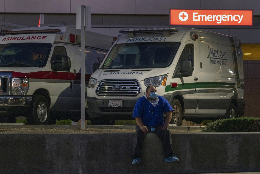 Darren Arthur, an environmental services worker, takes a break outside the Los Angeles County+USC Medical Center emergency ramp in Los Angeles, late W...