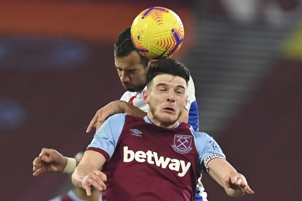 West Ham's Declan Rice, front, and Crystal Palace's Luka Milivojevic jump to head the ball during the English Premier League soccer match between West...