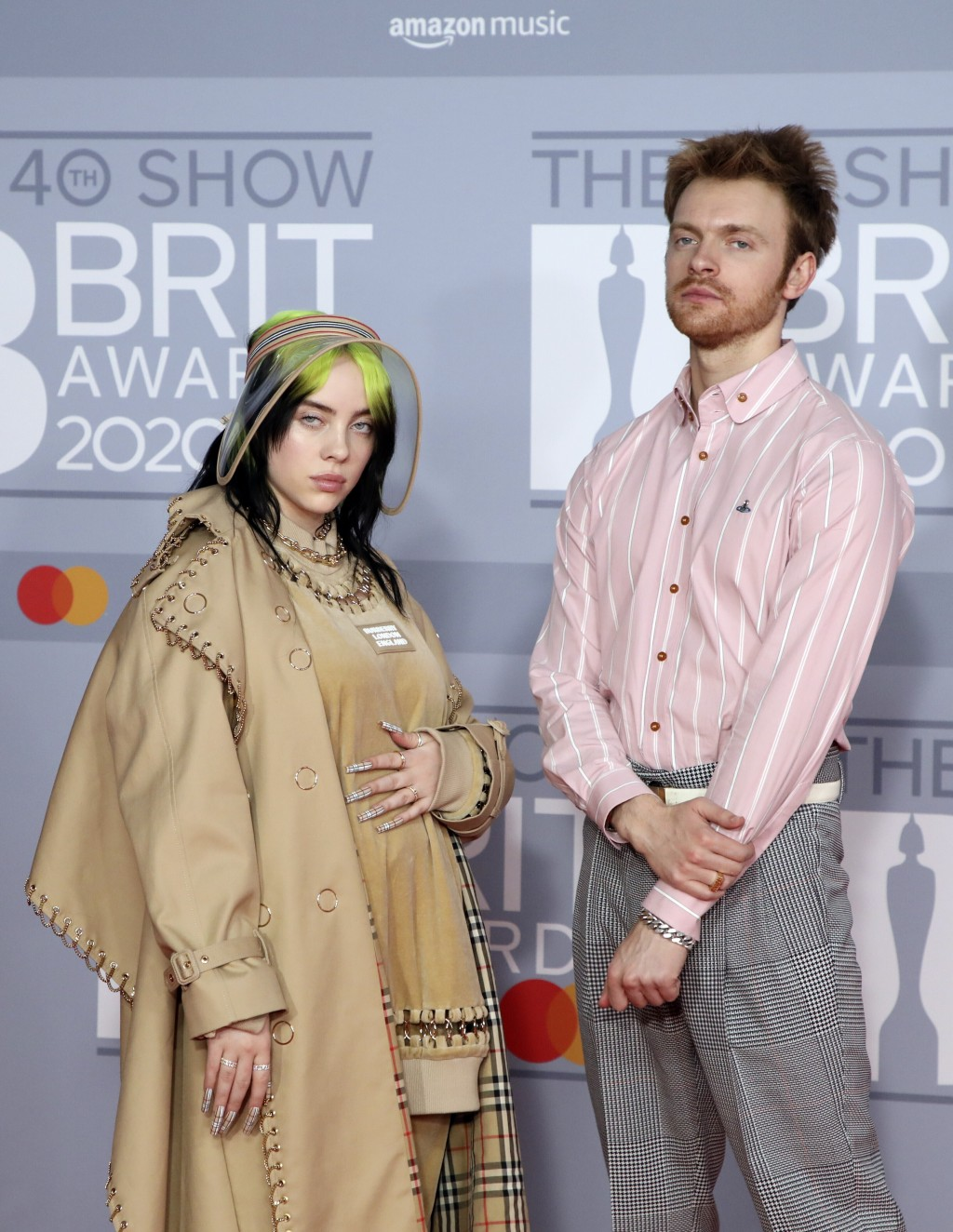 FILE - Billie Eilish, left, and Finneas O'Connell arrive at Brit Awards 2020 in London on Feb. 18, 2020.  O'Connell has been named one of The Associat...